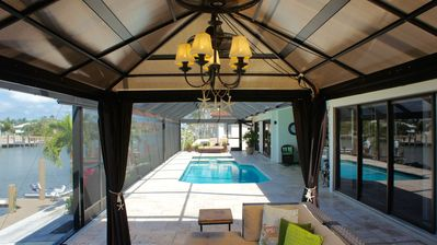 Gazebo with sectional seating, lights and dual fans