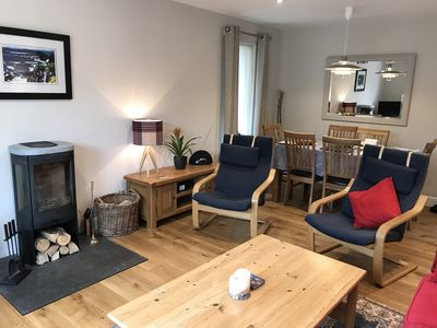 Couch and comfortable seating for six people. Log fire, smart tv. Dining table .