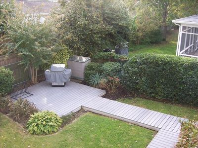 Looking down at backyard from second floor deck