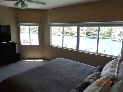 Oversized master bedroom, 60' smart tv,  with 5 large windows overlooking water