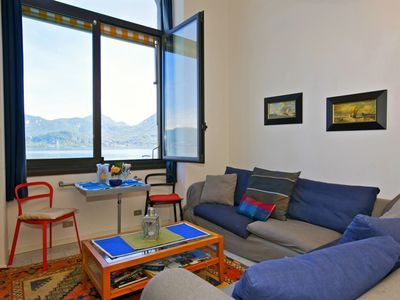 Photo for Spacious 2-room apartment with dream view and private beach directly by the lake