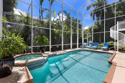 Heated screen enclosed Pool with hot tub for your late night enjoyment.