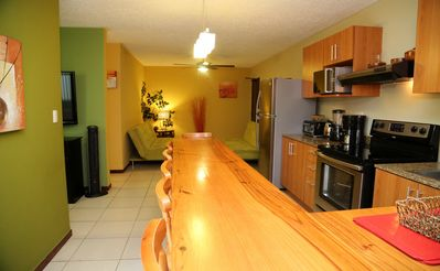 Well designed with dining bar & well equipped kitchen