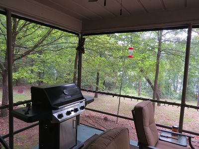 Screened in porch with gas grill