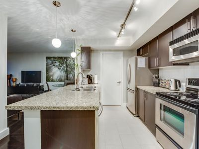 Photo for Modern 1 Bed with large outdoor patio with Fire-pit overlooking the park!