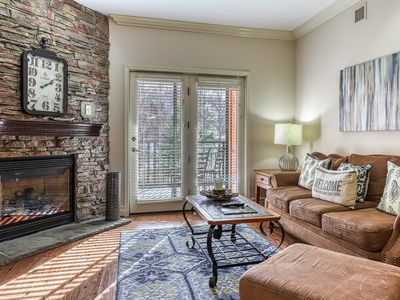 Photo for Elegant family condo right downtown w/ fireplace & shared hot tub/pool!