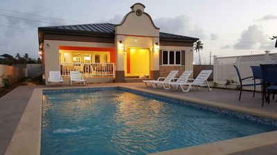 Pool, Pool Deck and front of villa at dusk