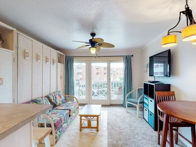 Photo for Cozy oceanfront condo w/ shared hot tub, pools, gym - close to beach!