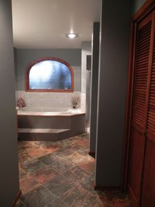 Linen closet found in Master bath has extra linens for your needs. New flooring