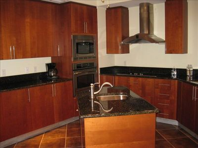 Beautiful kitchen with granite, stainless, wine cooler and an extra sink