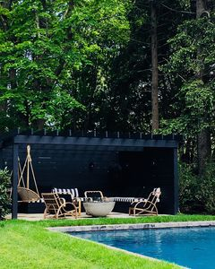 Pergola and Firepit for relaxing in shade by pool and gardens