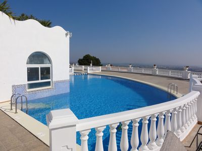 Photo for Penthouse apartment with pool, sea views, sleeps 6