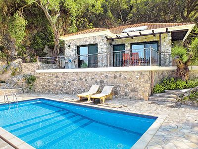 Photo for Stunning sea views, Stone villa w/ modern flair, pool, free A/C & Wi-Fi, overlooking Parga, in a complex of villas with complimentary breakfasts offered for 2019.