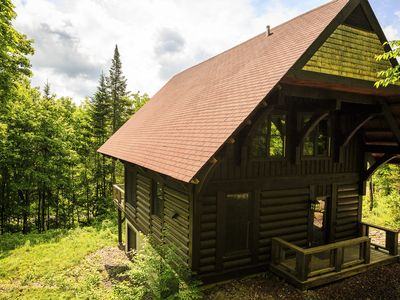Photo for Cozy 10 person Log Cabin in Mont Tremblant w/hot tub, sauna & indoor fireplace