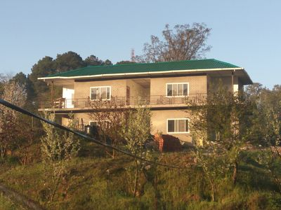 Photo for It  is surrounded by lush green mountains, with fruit garden & vegetable fields.