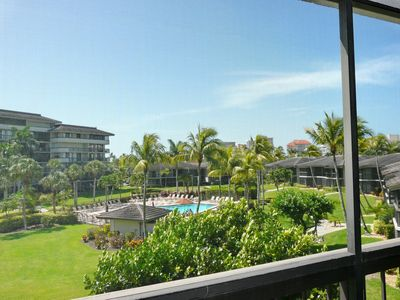 Photo for Stylish condo w/ heated pool, view of Clam Bay & walk to Tigertail Beach