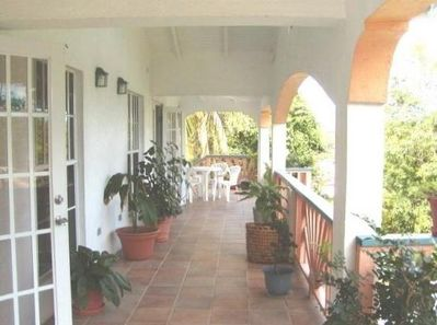 Palm Apartment porch and outside dining