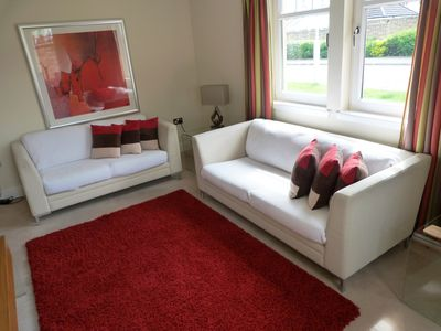 Lovely south facing lounge with two large bright windows.