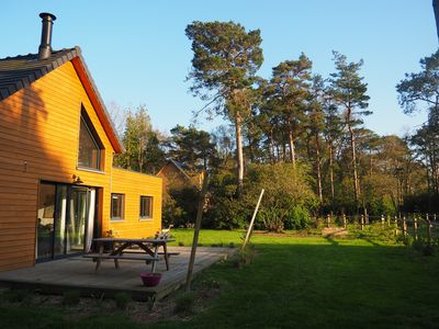 Photo for Nice wooden house 2 minutes from the sea in the middle of a pine forest