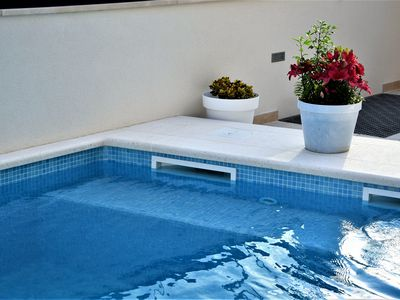 Photo for Modern apartment Ina with pool, terrace and sea view