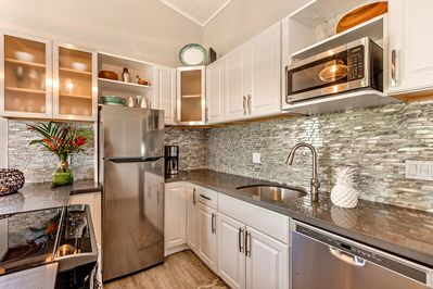 This kitchen is fully stocked beautiful glass backsplash, the kitchen is amazing
