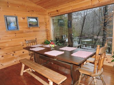 Photo for Beautiful river cabin w/ screen porch & deck over looking the river.