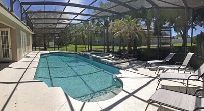 Photo for TWO MILES TO DISNEY, SPACIOUS HOUSE, ENORMOUS POOL AND THEATER ROOM!