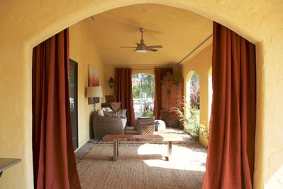 Private loggia with daybed located off of the front Master bedroom