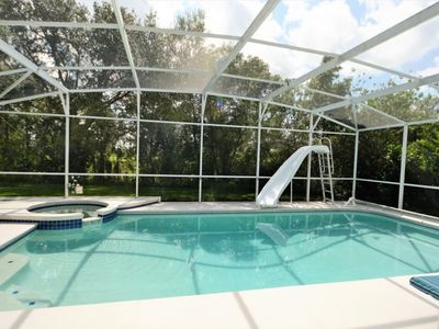 Photo for The most popular 4 Bedroom Pool Home with Water Slide!