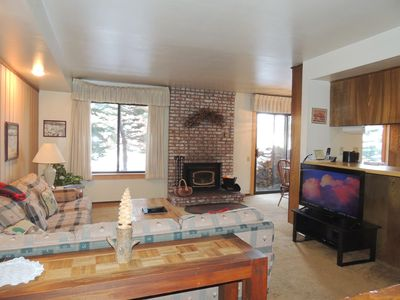 Photo for A comfortable downstairs one bedroom corner unit with light and trees, #105