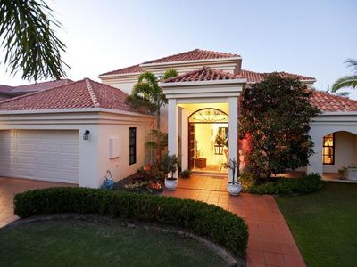 Photo for 4 bedroom stunning home on Canal, 5 minutes to the beach
