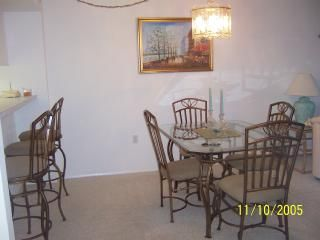 Dining area and eat in bar area, 4 extra folding chairs in master closet