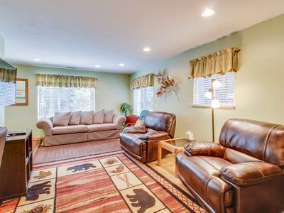 Photo for Conveniently located  w/ large deck & fireplace - all the comforts of home!