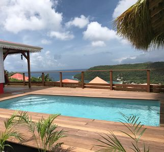 Photo for New villa with swimming pool, magnificent view of the caribbean sea, 1 'from the beach