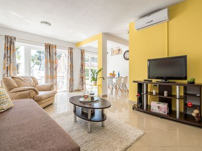 Photo for Modern & freshly decorated apartment with terrace,  just steps from the beach