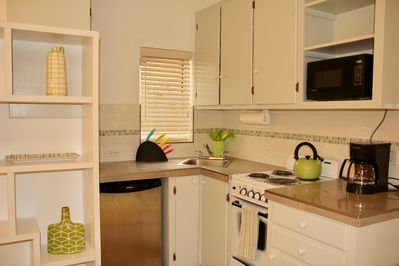 Fully stocked kitchen w/fridge, stove/oven, microwave, complete set of pot and two sets of dishes, indoor & outdoor.