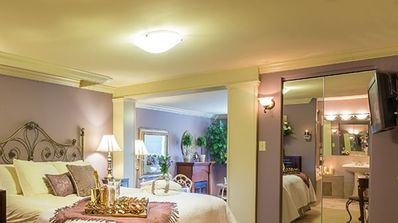 Imperial Jacuzzi Suite has a king size bed and ensuite with double Jacuzzi tub