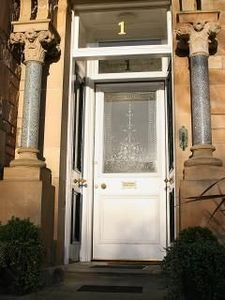 Front entrance with original etched glass doorway and marble pillars