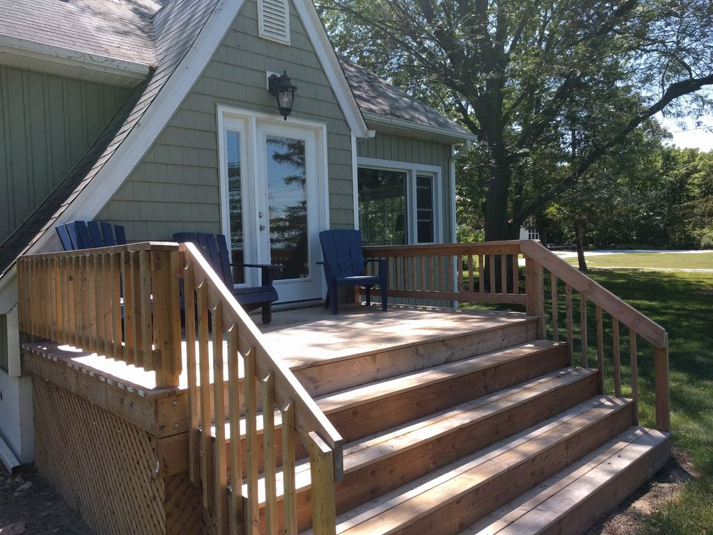 Renovated North Shore Craftsman, Lakefront with Nine Acres of Bird-Filled Forest