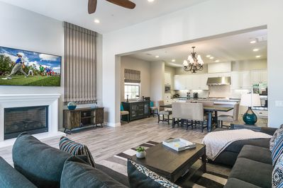 """Living Room - Relax on a comfy sectional sofa and catch up on your favorite shows on the huge 74"""" flat-screen TV."""