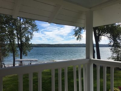 Owasco Lake front seasonal cottage with level yard and beach