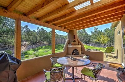Relax with loved ones on the spacious and shaded back porch.