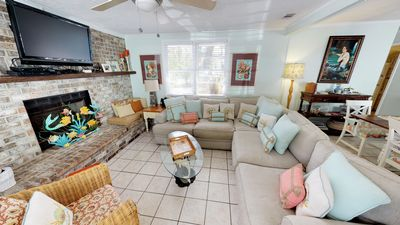 This charming Tybee home has lots of room inside and out for family and friends