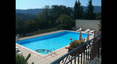 Photo for Luberon apartment with pool and view