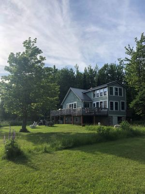 Photo for Madeline Island cottage within steps of sandy shoreline!