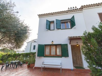 Photo for 4 bedroom Villa, sleeps 8 with Air Con, WiFi and Walk to Beach & Shops