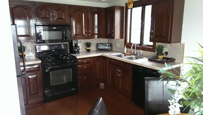 Fully outfitted kitchen with dishwasher, microwave and coffee maker