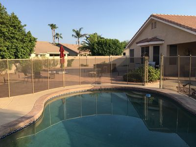 Large, inviting backyard to enjoy your holiday.  New Safety Pool Fence.
