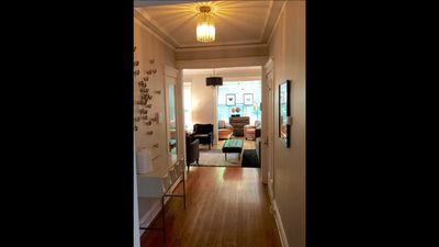 This is a look from the entry / foyer into the living room & front sunroom.