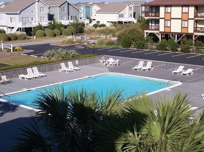 View of our large pool, plenty of chairs and grills around.